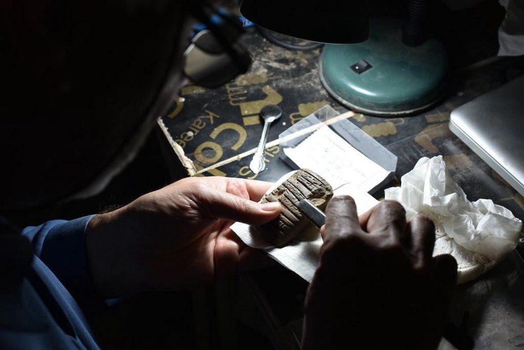 A modern Sumerologist examining a Sumerian tablet