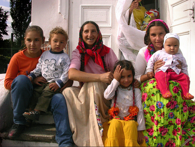 A modern Romani woman, surrounded by her family
